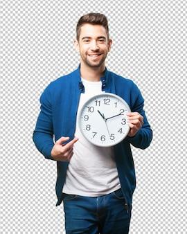 Homem jovem, segurando, um, relógio