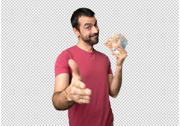 Homem levando muito dinheiro apertando as mãos para fechar um bom negócio