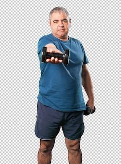 Homem maduro, fazendo, exercício, com, dumbbell