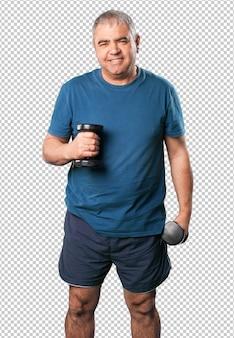 Homem maduro, fazendo exercícios com halteres