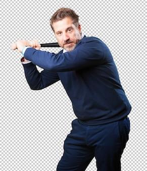 Homem maduro, jogando basebol