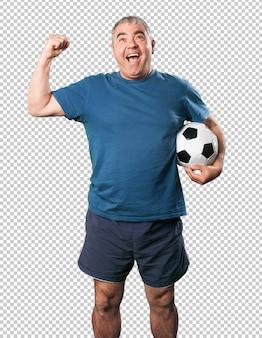 Homem maduro, tocando, com, bola futebol