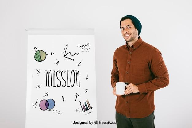 Homem moderno posando com quadro branco e caneca