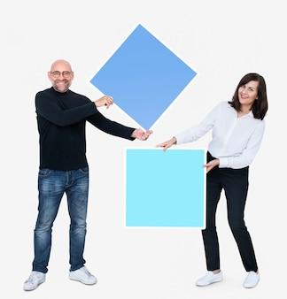 Homem mulher, segurando, quadrados