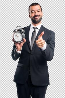 Homem negócios, segurando, vindima, relógio