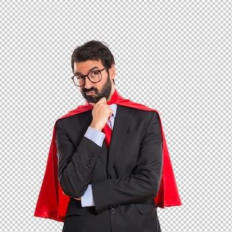 Homem negócios, vestido, como, superhero, pensando, sobre, branca