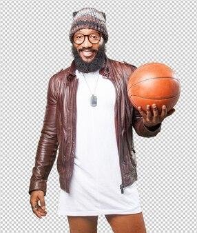 Homem negro brincando com uma bola de basquete