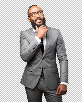Homem negro de negócios pensando