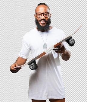 Homem negro, segurando, um, skateboard
