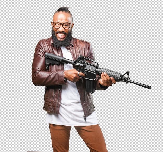 Homem negro, segurando uma arma