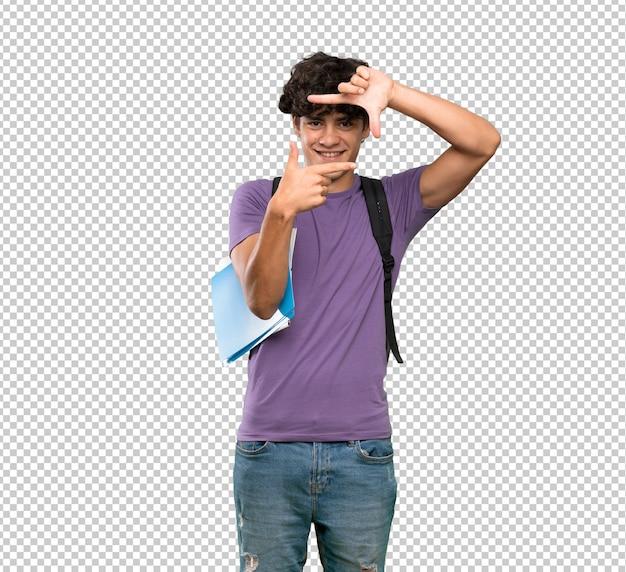 Homem novo do estudante que focaliza a face. símbolo de enquadramento