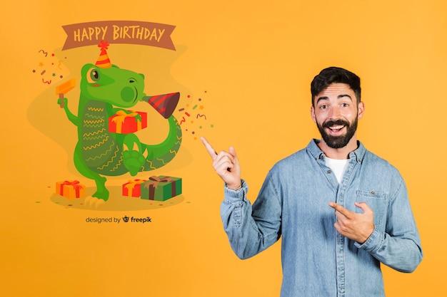 Homem sorridente, apontando os dedos para uma mensagem de feliz aniversário