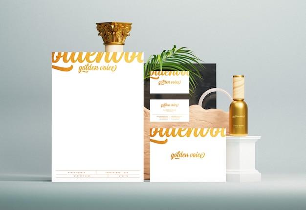 Identidade de marca corporativa e maquete de papelaria com efeito de impressão de folha de ouro