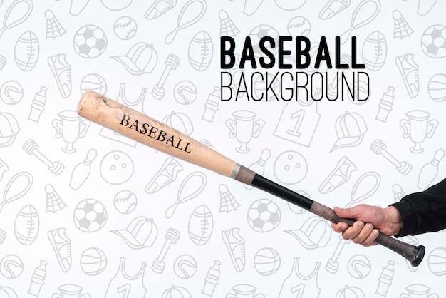 Jogador segurando o taco de beisebol