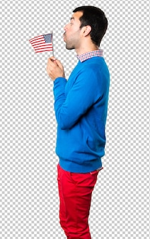 Jovem bonito segurando uma bandeira americana