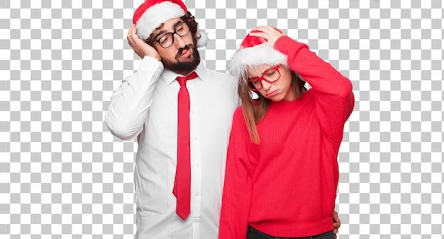 Jovem casal expressando o conceito de natal. casal e plano de fundo em diferentes camadas