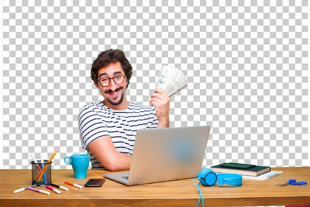 Jovem designer gráfico louco em uma mesa com um laptop e pagar, comprar ou conceito de dinheiro