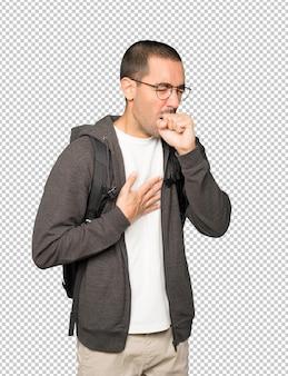 Jovem estudante doente tossindo