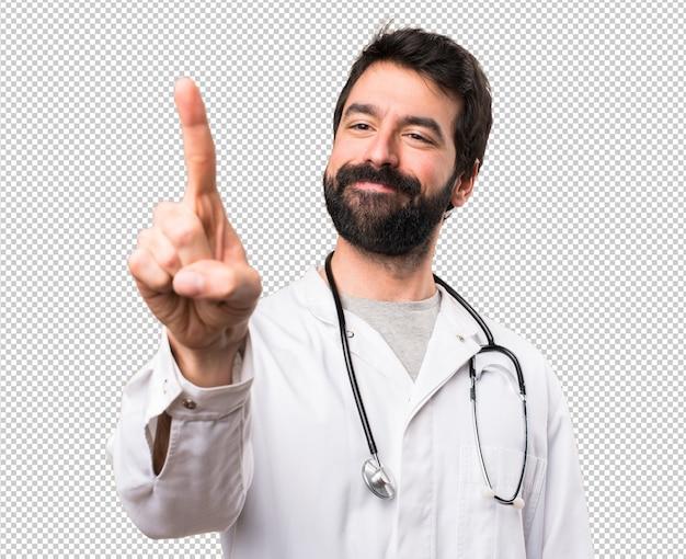 Jovem médico tocando na tela transparente
