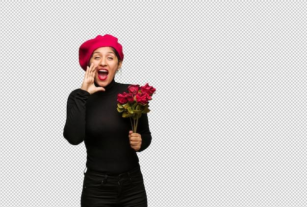Jovem mulher no dia dos namorados gritando algo feliz para a frente