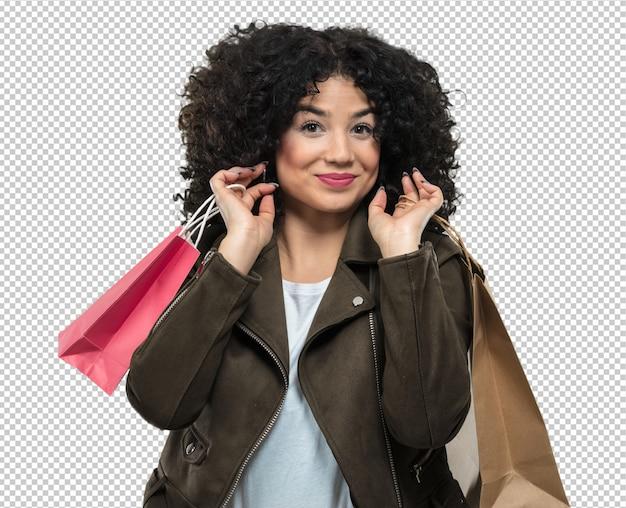 Jovem mulher segurando sacolas de compras