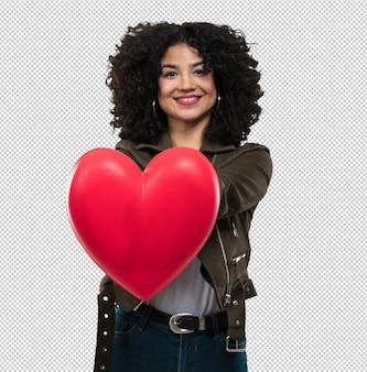 Jovem mulher segurando uma forma de coração