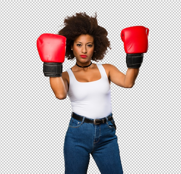 Jovem negra usando luvas de boxe