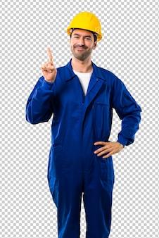 Jovem, trabalhador, com, capacete, mostrando, e, levantamento, um, dedo, em, sinal, de, a, melhor