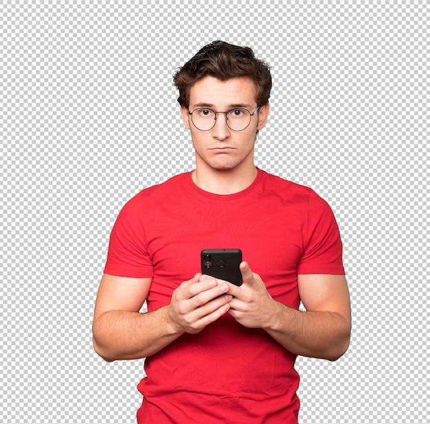 Jovem triste usando um telefone celular
