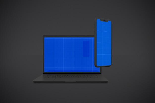 Laptop escuro e maquete móvel