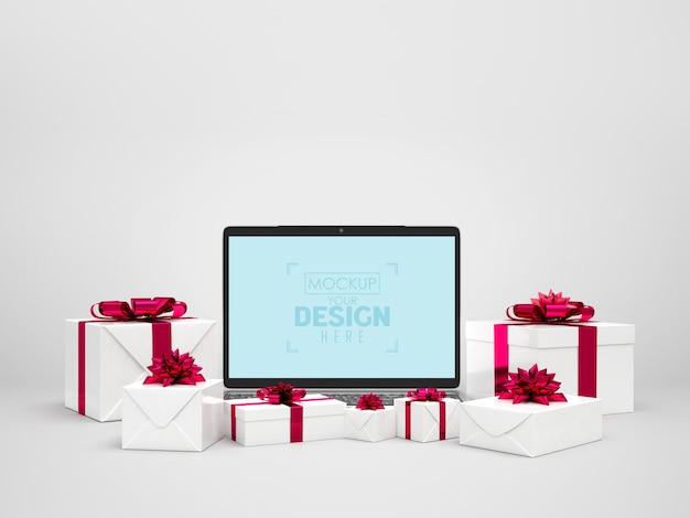 Laptop rodeado de presentes
