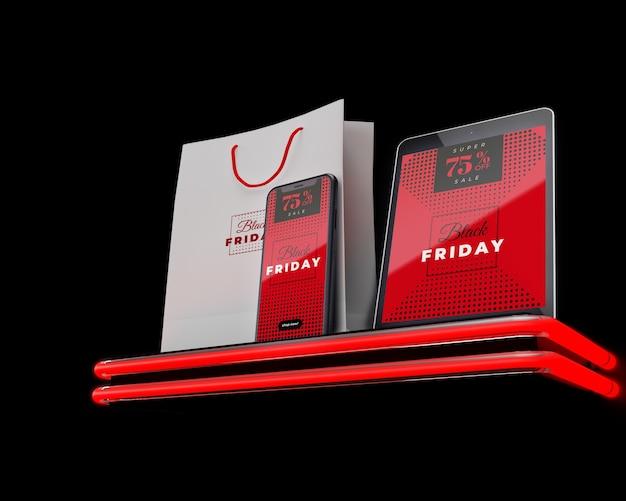 Letras de néon sexta-feira negra em dispositivos eletrônicos