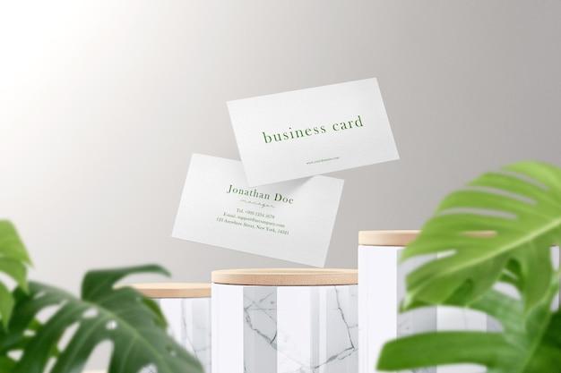 Limpe a maquete de cartão de visita mínima flutuando no pote de mármore com folhas