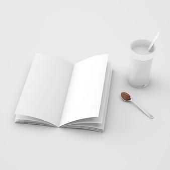 Livro aberto e colher com café