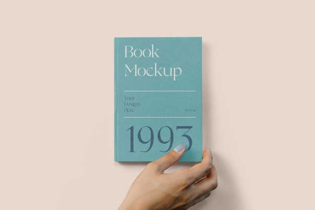Livro de capa dura com maquete de mão