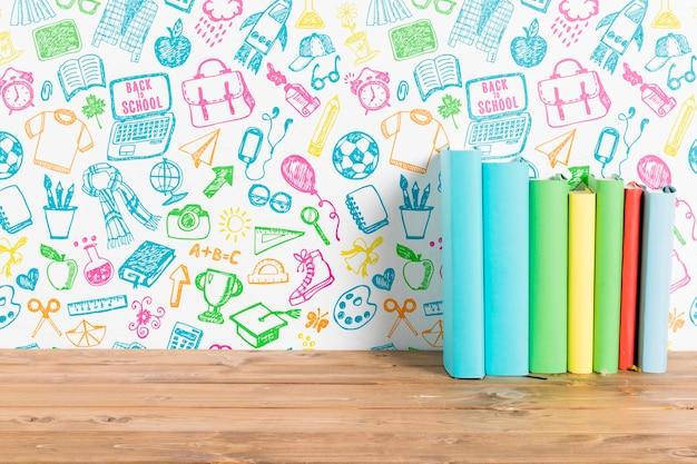 Livros de vista frontal com fundo colorido
