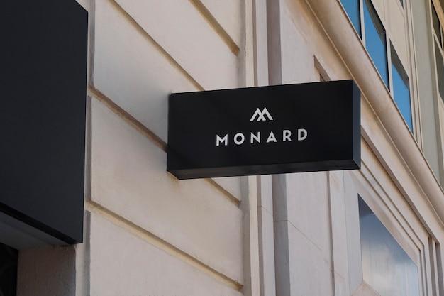 Logo mockup black hanging wall sign