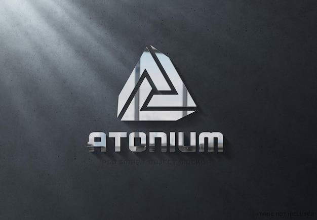 Logotipo 3d de metal brilhante em maquete de parede escura