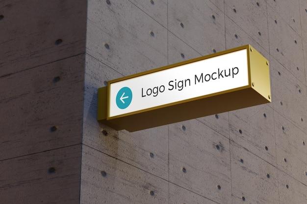 Logotipo da caixa de sinalização retangular maquete na fachada do prédio de escritórios
