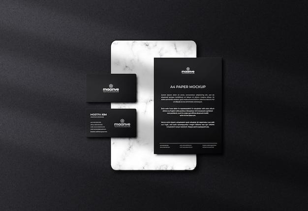 Logotipo de cartão de visita escuro de luxo e maquete de papel timbrado