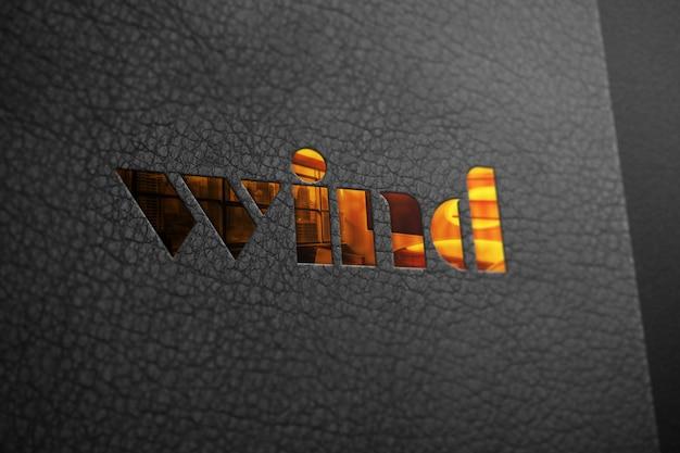Logotipo de maquete dourado na textura de couro preto