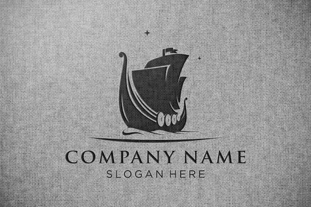 Logotipo de maquete preto na textura da tela