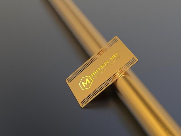Logotipo de metal dourado na maquete do cartão de visita