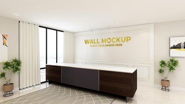 Logotipo dourado na maquete da sala da recepcionista