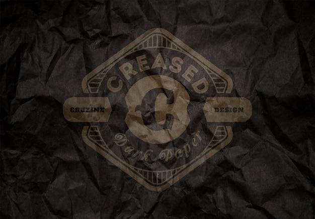 Logotipo em papel escuro vincado