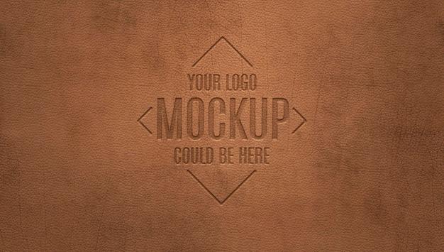 Logotipo em relevo em maquete de couro marrom