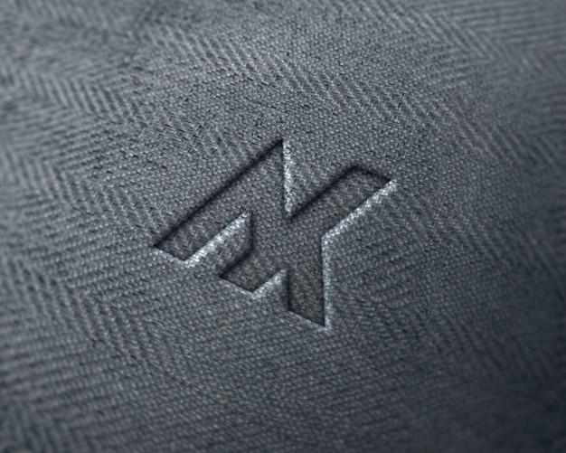Logotipo realista na maquete de tecido jeans