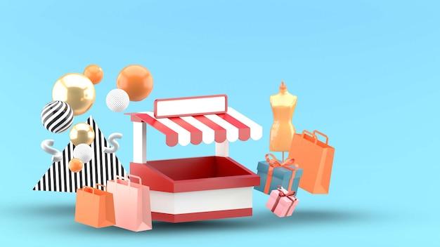 Loja e sacola de compras no azul