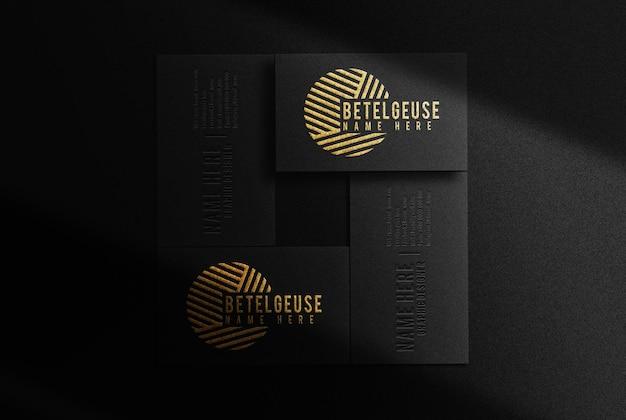 Luxo betelgeuse ouro em relevo com quatro cartões de visita maquete de vista superior