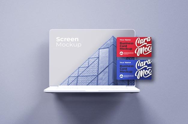 Macbook pro branco com vista frontal da maquete do cartão de visita